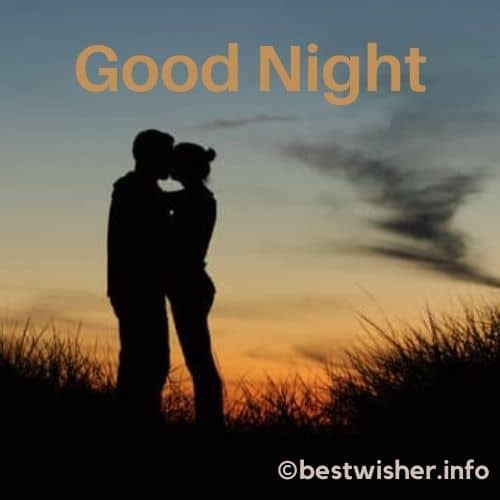 couple kissing intimately at night